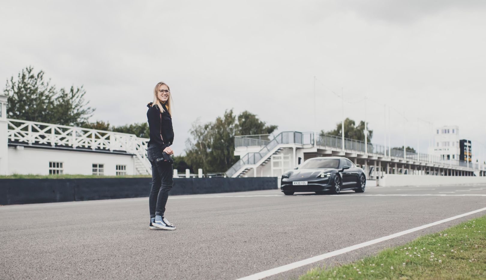"A photo of the photographer: Amy and ""her"" Taycan—a happy ending on the long straights of Goodwood."