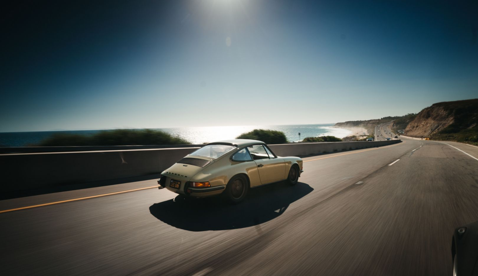 Pacific Coast Highway: engine, wind, and waves. That's all you need for Porsche happiness.