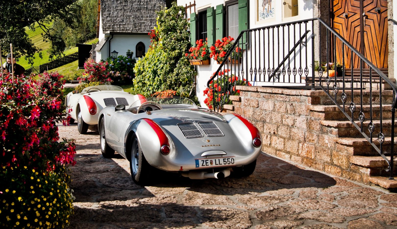 Two Porsche 550 Spyders; two examples of the brand's first true sports car; two classic cars in the idyllic Alps—fun to look at and even more fun to drive.