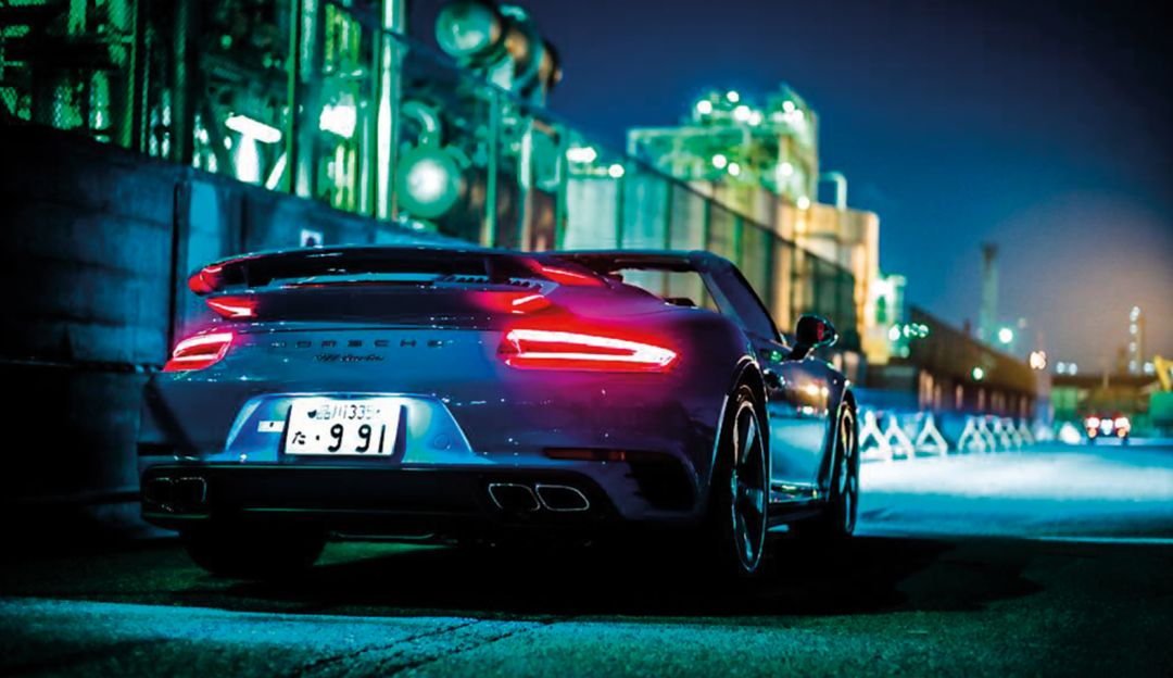 Light show: Exploring an industrial area of Tokyo with a 911 Turbo Cabriolet.